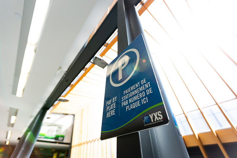 Pay by Plate sign within terminal